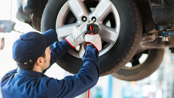 an image of one of our experts having tyres serviced